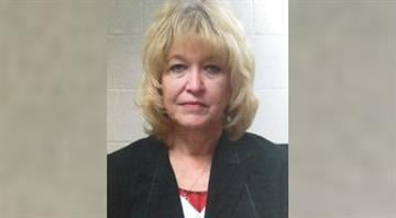 Janet Hopkins, 62, of House Springs, was arrested and charged with stealing. By Dan Mueller