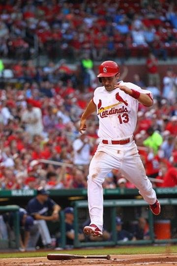 ST. LOUIS, MO - MAY 17: Matt Carpenter #13 of the St. Louis Cardinals scores a run against the Milwaukee Brewers in the first inning at Busch Stadium on May 17, 2013 in St. Louis, Missouri. (Photo by Dilip Vishwanat/Getty Images) By Dilip Vishwanat