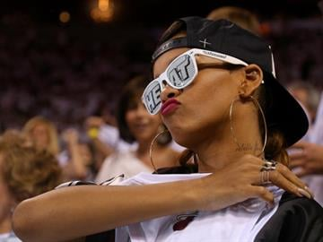 Rihanna attends Game One of the Eastern Conference Quarterfinals of the 2013 NBA Playoffs between the Miami Heat and the Milwaukee Bucks at American Airlines Arena on April 21, 2013, in Miami, Fla.