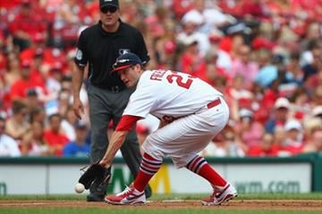 ST. LOUIS, MO - MAY 19: David Freese #23 of the St. Louis Cardinals fields a ground ball against the Milwaukee Brewers at Busch Stadium on May 19, 2013 in St. Louis, Missouri.  (Photo by Dilip Vishwanat/Getty Images) By Dilip Vishwanat