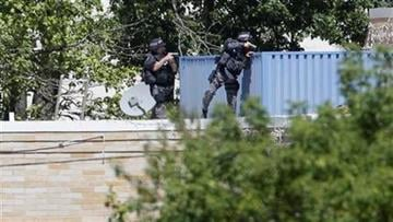 Armed police investigate the Sikh Temple in Oak Creek, Wis. where a shooting took place on Sunday, Aug. 5, 2012. (AP Photo/Jeffrey Phelps) By Jeffrey Phelps