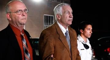 Former Penn State assistant football coach Jerry Sandusky leaves the Centre County Courthouse in handcuffs after a jury found him guilty in his sex abuse trial June 22, 2012, in Bellefonte, Pa. (Getty Images)