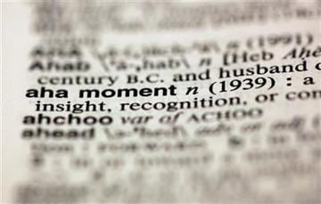 "The entry ""aha moment,"" photographed in New York,  Friday, Aug. 10, 2012, is one of the 15 new additions in the 11th edition of Merriam-Webster's Collegiate Dictionary. (AP Photo/Richard Drew) By Richard Drew"