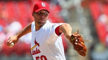 Starter Adam Wainwright #50 of the St. Louis Cardinals pitches against the San Francisco Giants at Busch Stadium on August 9, 2012 in St. Louis, Missouri.  (Photo by Dilip Vishwanat/Getty Images) By Dilip Vishwanat