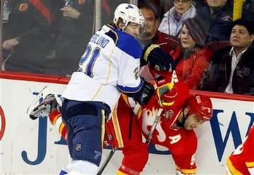 St. Louis Blues' Patrick Berglund, from Sweden, left, checks Calgary Flames' Mark Giordano during first period NHL hockey action in Calgary, Alberta, Monday, Feb. 27, 2012.(AP Photo/The Canadian Press, Jeff McIntosh) By Jeff McIntosh