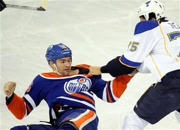 St. Louis Blues' Ryan Reaves, right, fights with Edmonton Oilers'  Darcy Hordichuk during the first period of an NHL hockey game in Edmonton, Alberta, on Wednesday, Feb. 29,  2012. (AP Photo/The Canadian Press, John Ulan) By John Ulan