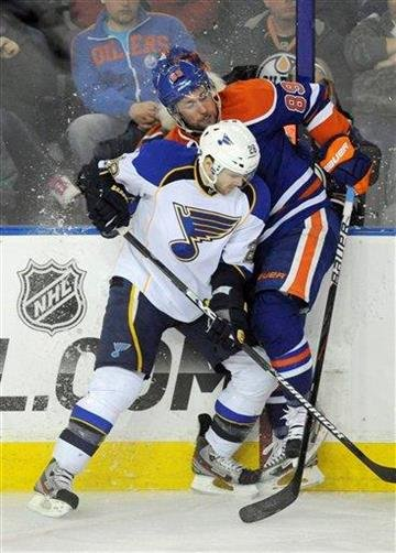 St Louis Blues Carlo Colaiacovo, left, checks Edmonton Oilers'  Sam Gagner during third period  NHL hockey game action in Edmonton, Alberta, on Wednesday, Feb. 29, 2012. (AP Photo/THE CANADIAN PRESS/John Ulan) By John Ulan