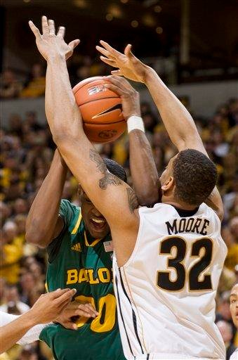 Baylor's Quincy Miller, left, fights his way past Missouri's Steve Moore, right, as he tries to shoot during the first half of an NCAA college basketball game, Saturday, Feb. 11, 2012, in Columbia, Mo. (AP Photo/L.G. Patterson) By L.G. PATTERSON