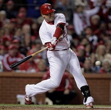 St. Louis Cardinals' Allen Craig hits an RBI single during the seventh inning of Game 2 of baseball's World Series against the Texas Rangers Thursday, Oct. 20, 2011, in St. Louis. (AP Photo/Charlie Riedel) By Charlie Riedel