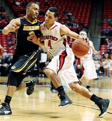 Texas Tech's Ty Nurse (4) drives on Missouri's Matt Pressey during their NCAA college basketball game in Lubbock, Texas, Saturday, March 3, 2012. (AP Photo/The Avalanche-Journal, Zach Long) ALL LOCAL TV OUT By Zach Long