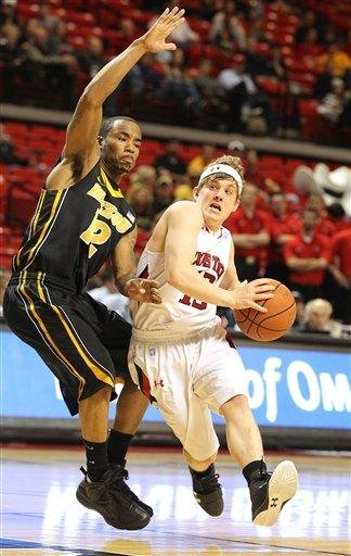 Texas Tech's Luke Adams drives against Missouri's Marcus Denmon during an NCAA college basketball game in Lubbock, Texas, Saturday, March 3, 2012. (AP Photo/Lubbock Avalanche-Journal, Zach Long) ALL LOCAL TV OUT By Zach Long