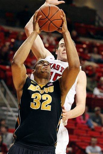 Missouri's Steve Moore (32) shoots under pressure from Texas Tech's Robert Lewandowski during their NCAA college basketball game in Lubbock, Texas, Saturday, March 3, 2012. (AP Photo/The Avalanche-Journal, Zach Long) ALL LOCAL TV OUT By Zach Long