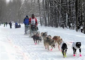 Matt Giblin mushes through the University Lake area during the ceremonial start of the Iditarod Trail Sled Dog Race, Saturday, March 3, 2012, in Archorage, Alaska. (AP Photo/Anchorage Daily News, Erik Hill) By Erik Hill