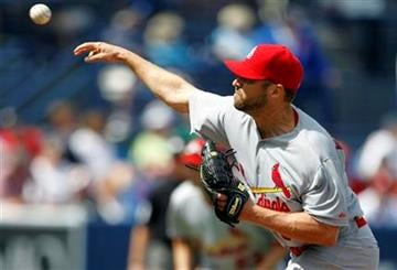 St. Louis Cardinals pitcher Jake Westbrook throws during the first inning of a spring training baseball game against the New York Mets on Tuesday, March 6, 2012, in Port St. Lucie, Fla. (AP Photo/Jeff Roberson) By Jeff Roberson