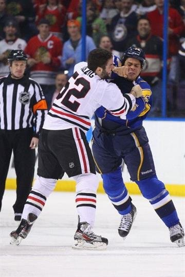 ST. LOUIS, MO - MARCH 6: Ryan Reaves #75 of the St. Louis Blues fights Brandon Bollig #52 of the Chicago Blackhawks at the Scottrade Center  on March 6, 2012 in St. Louis, Missouri.  (Photo by Dilip Vishwanat/Getty Images) By Dilip Vishwanat