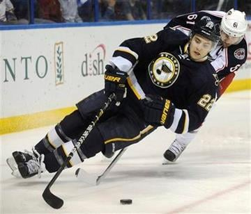 St. Louis Blues' Kevin Shattenkirk (22) skates around Columbus Blue Jackets' Rick Nash (61) in the first period of an NHL hockey game on Saturday, March 10, 2012, in St. Louis. (AP Photo/Bill Boyce) By Bill Boyce