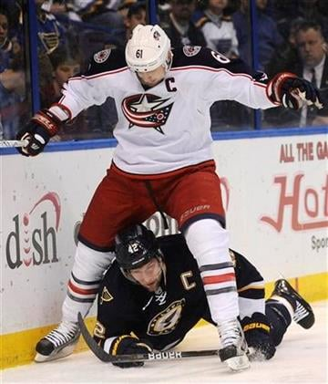 Columbus Blue Jackets' Rick Nash (61) jumps over St. Louis Blues' David Backes (42) in the first period of an NHL hockey game on Saturday, March 10, 2012, in St. Louis. (AP Photo/Bill Boyce) By Bill Boyce