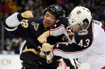 St. Louis Blues' Chris Porter (32) fights with Columbus Blue Jackets' Darryl Boyce (43) in the first period of an NHL hockey game on Saturday, March 10, 2012, in St. Louis. (AP Photo/Bill Boyce) By Bill Boyce