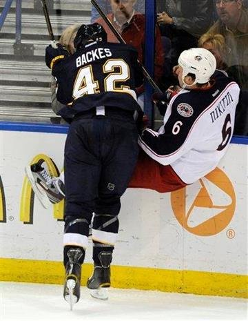 St. Louis Blues' David Backes (42) checks Columbus Blue Jackets' Nikita Nikitin (6), of Russia, in the second period of an NHL hockey game on Saturday, March 10, 2012, in St. Louis. The Blues won 4-1. (AP Photo/Bill Boyce) By Bill Boyce