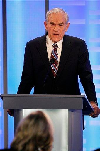 Rep. Ron Paul, R-Texas, answers a question during a Republican presidential candidate debate at Saint Anselm College in Manchester, N.H., Saturday, Jan. 7, 2012. (AP Photo/Elise Amendola) By Elise Amendola