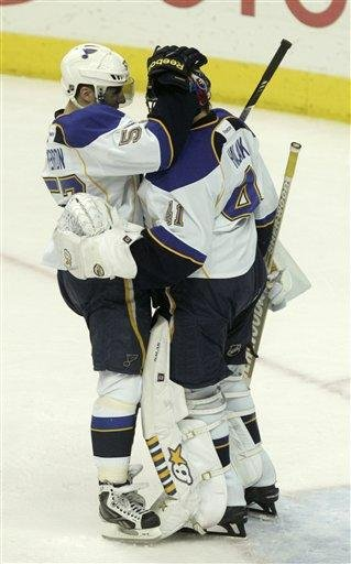 St. Louis Blues' David Perron, left, celebrates with goalie Jaroslav Halak of Slovakia after the Blues' 2-1 NHL hockey game win over the Columbus Blue Jackets in Columbus, Ohio,  Sunday, March 11, 2012. (AP Photo/Paul Vernon) By Paul Vernon