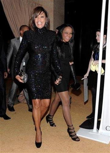 Singer Whitney Houston, left, and daughter Bobbi Kristina Brown arrive at the Pre-Grammy Gala & Salute to Industry Icons with Clive Davis honoring David Geffen on Saturday, Feb. 12, 2011 in Beverly Hills, Calif. (AP Photo/Dan Steinberg) By Dan Steinberg