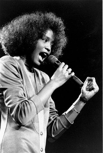 In this May 10, 1986, file photo, American singer Whitney Houston belts out a song during her segment of a benefit concert at Boston Garden. Houston died Saturday, Feb. 11, 2012, she was 48. (AP Photo/Elise Amendola) By ELISE AMENDOLA