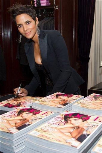 Halle Berry signs copies of her Vogue magazine cover at the Ralph Lauren Madison Avenue store for Fashion's Night Out in New York, Friday, September 10, 2010. (AP Photo/Charles Sykes) By Charles Sykes
