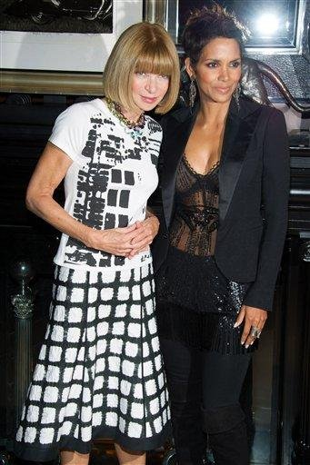 Anna Wintour, left, and Halle Berry appear at the Ralph Lauren Madison Avenue store for Fashion's Night Out in New York, Friday, Sept. 10, 2010. (AP Photo/Charles Sykes) By Charles Sykes