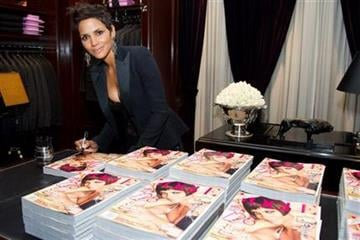Halle Berry signs copies of her Vogue magazine cover at the Ralph Lauren Madison Avenue store for Fashion's Night Out in New York, Friday, Sept. 10, 2010. (AP Photo/Charles Sykes) By Charles Sykes