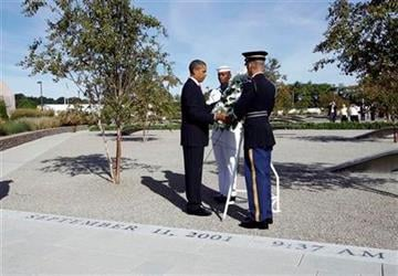 President Barack Obama lays a wreath at the Pentagon Memorial, marking the ninth anniversary of the September 11 attacks, Saturday, Sept. 11, 2010. (AP Photo/Charles Dharapak) By Charles Dharapak