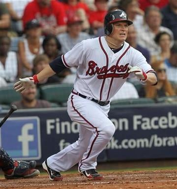 Atlanta Braves center fielder Nate McLouth (24) watches his hit go for an RBI triple in the fifth inning of a baseball game against the St. Louis Cardinals  in Atlanta, on Saturday, Sept. 11, 2010. (AP Photo/John Bazemore) By John Bazemore