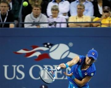 Kim Clijsters, of Belgium,  serves to Vera Zvonareva, of Russia, during a women's championship match at the U.S. Open tennis tournament in New York, Saturday, Sept. 11, 2010.  (AP Photo/Paul J. Bereswill) By Paul J. Bereswill