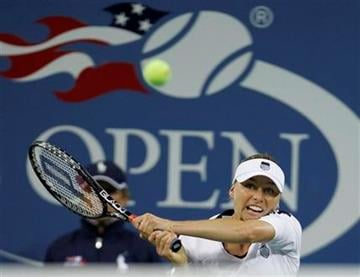 Vera Zvonareva, of Russia, returns the ball to Kim Clijsters, of Belgium, during a women's championship match at the U.S. Open tennis tournament in New York, Saturday, Sept. 11, 2010.  (AP Photo/Paul J. Bereswill) By Paul J. Bereswill