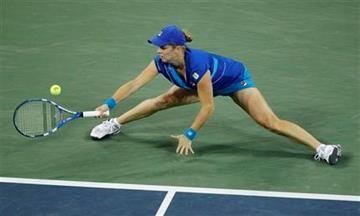 Kim Clijsters, of Belgium, returns the ball to Vera Zvonareva, of Russia, during a women's championship match at the U.S. Open tennis tournament in New York, Saturday, Sept. 11, 2010.  (AP Photo/Paul J. Bereswill) By Paul J. Bereswill