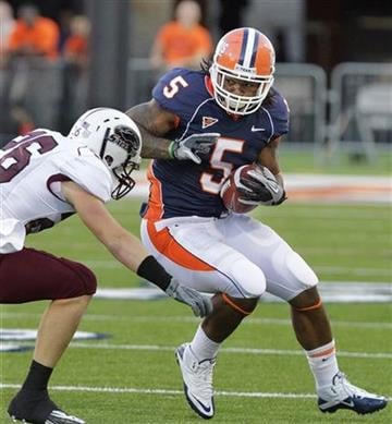 Illinois running back Mikel Leshoure (5) runs against Southern Illinois safety Mike McElroy, left, during the first half of the NCAA college football game in Champaign, Ill., Saturday, Sept. 11, 2010. (AP Photo/Seth Perlman) By Seth Perlman