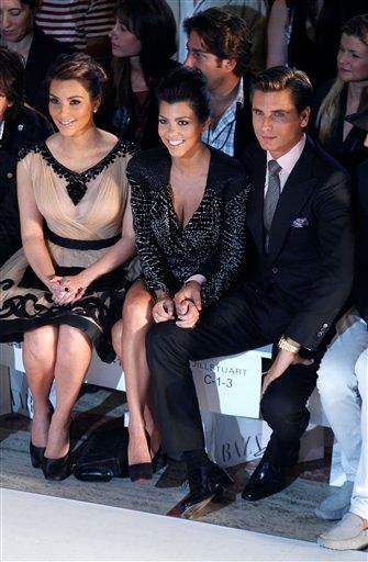 Reality stars Kim Kardashian, Kourtney Kardashian and Scott Disick attend the Jill Stuart Spring 2011 collection during fashion week at Lincoln Center, in New York, on Saturday, Sept. 11, 2010. (AP Photo/Peter Kramer) By Peter Kramer