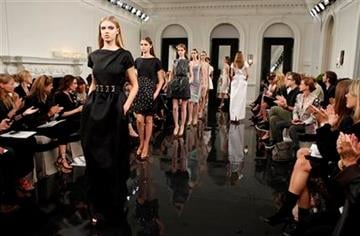 Models walk the runway at the Victoria Beckham Spring 2011 collection, in New York, on Sunday, Sept. 12, 2010.  (AP Photo/Peter Kramer) By Peter Kramer