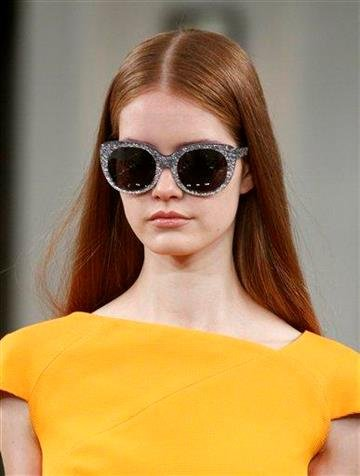 A model walks the runway at the Victoria Beckham Spring 2011 collection, in New York, on Sunday, Sept. 12, 2010.  (AP Photo/Peter Kramer) By Peter Kramer
