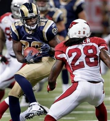 St. Louis Rams wide receiver Mark Clayton, left, catches a 5-yard pass as Arizona Cardinals cornerback Greg Toler defends during the second quarter of an NFL football game Sunday, Sept. 12, 2010, in St. Louis. (AP Photo/Tom Gannam) By Tom Gannam