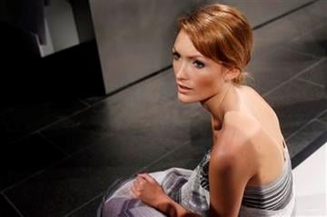 A model waits for the start of the presentation of Chris Benz spring 2011 collection during Fashion Week in New York, Monday, Sept. 13, 2010.  (AP Photo/Seth Wenig) By Seth Wenig