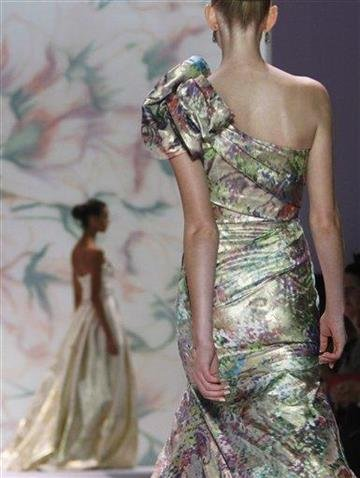 Fashion from the Monique Lhuillier Spring 2011 collection is modeled, Monday Sept. 13, 2010, during Fashion Week in New York. (AP Photo/Bebeto Matthews) By BEBETO MATTHEWS