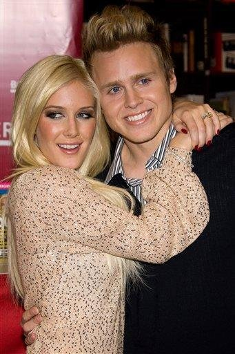 """FILE - In this Nov. 16, 2009 file photo, Heidi Montag, left, and Spencer Pratt pose at a book signing event for their book """"How To Be Famous"""" at Borders Books in New York. (AP Photo/Charles Sykes, file) By Charles Sykes"""