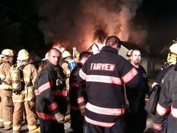 Firefighters at the scene of a fire in Fairview Heights, Illinois on Monday, September 13, 2010.