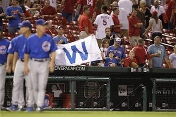 Chicago Cubs fans hold up a large W after they Cubs beat the St. Louis Cardinals 5-1 in a baseball game, Monday, Sept. 13, 2010 in St. Louis. (AP Photo/Tom Gannam) By Tom Gannam