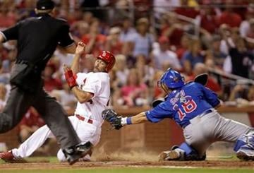 St. Louis Cardinals' Randy Winn scores from second on a single by Matt Holliday as Chicago Cubs catcher Geovany Soto applies the late tag in the seventh inning of a baseball game, Monday, Sept. 13, 2010 in St. Louis. (AP Photo/Tom Gannam) By Tom Gannam