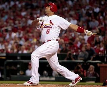 St. Louis Cardinals' Albert Pujols hits an RBI sacrifice fly to score teammate Jon Jay during the first inning of a baseball game against the Cincinnati Reds Friday, Sept. 3, 2010, in St. Louis. (AP Photo/Jeff Roberson) By Jeff Roberson