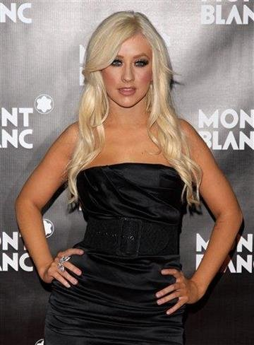 Singer Christina Aguilera attends the global launch of the Montblanc John Lennon edition writing instrument, in New York, on Sunday, Sept. 12, 2010. (AP Photo/Peter Kramer) By Peter Kramer