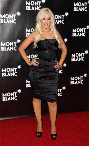 Singer Christina Aguilera attends the global launch of the Montblanc John Lennon edition writing instrument, in New York, on Sunday, Sept. 12, 2010. (AP Photo/Peter Kramer) By Peter Kramer
