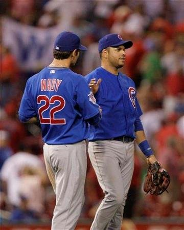 Chicago Cubs' Xavier Nady (22) celebrates with Aramis Ramirez after the ninth inning of a baseball game, Tuesday, Sept. 14, 2010 in St. Louis. The Cubs beat the Cardinals 7-2.(AP Photo/Tom Gannam) By Tom Gannam